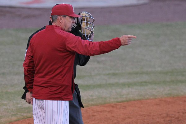 Arkansas coach Dave Van Horn speaks with umpire Michael Phillips during a game against Grambling State on Tuesday, April 10, 2018, in North Little Rock.
