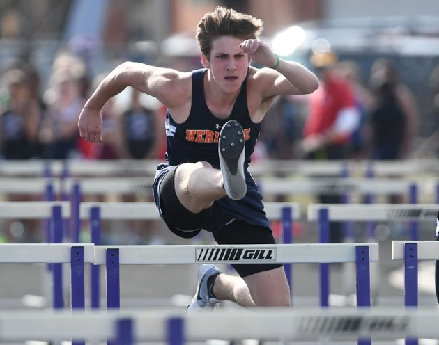 nwa-democrat-gazettejt-wampler-rogers-heritages-liam-alderson-competes-in-the-110-meter-hurdles-wednesday-april-11-2018-at-the-bulldog-relays-in-fayetteville