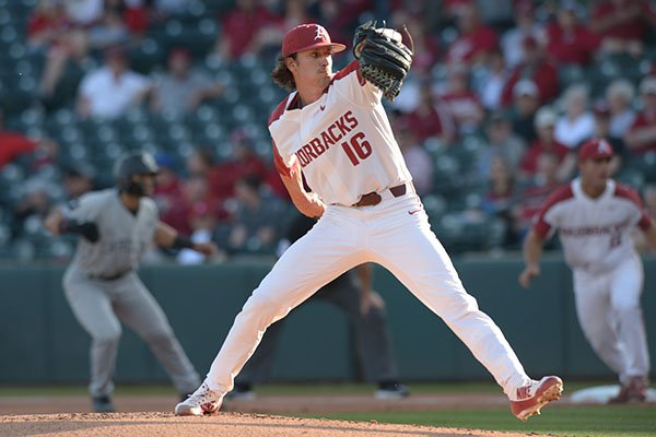 Arkansas starter Blaine Knight delivers to the plate Thursday, April 12, 2018, during the first inning against South Carolina at Baum Stadium in Fayetteville.