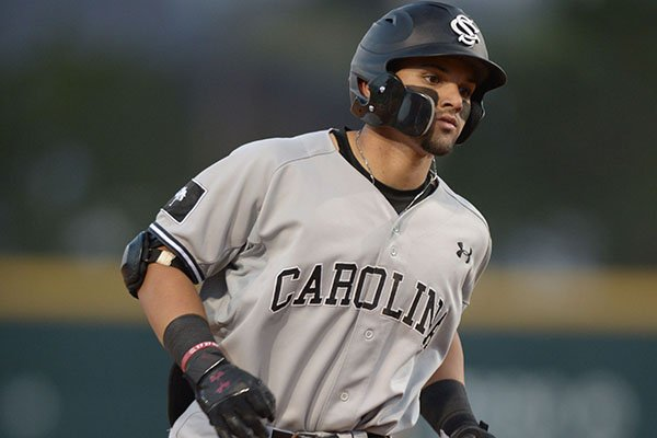 South Carolina outfielder Carlos Cortes rounds third base after hitting a home run during a game against Arkansas on Thursday, April 12, 2018, in Fayetteville.