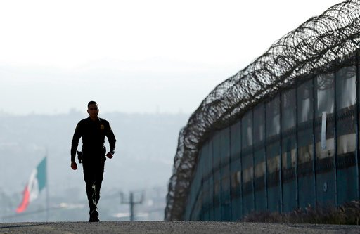 file-in-this-june-22-2016-file-photo-border-patrol-agent-eduardo-olmos-walks-near-the-secondary-fence-separating-tijuana-mexico-background-and-san-diego-in-san-diego-california-gov-jerry-brown-agreed-wednesday-april-11-2018-to-deploy-400-national-guard-troops-at-president-donald-trumps-request-but-not-all-will-head-to-the-us-mexico-border-as-trump-wants-and-none-will-enforce-federal-immigration-enforcement-ap-photogregory-bull-file