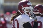Arkansas tight end Will Gragg goes through practice Saturday, March 3, 2018, in Fayetteville.