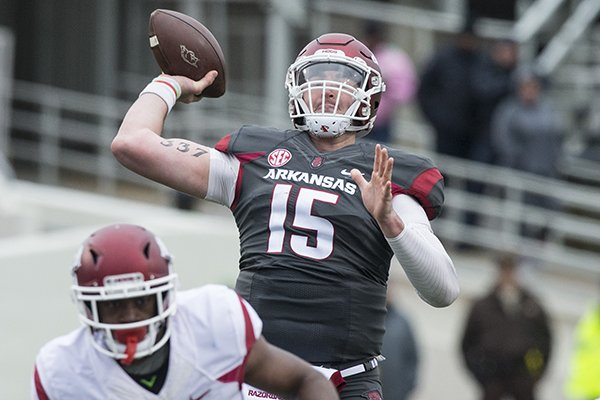 Arkansas quarterback Cole Kelley (15) throws a pass during the Razorbacks' spring game Saturday, April 7, 2018, in Little Rock.