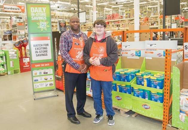 batesville-home-depot-store-manager-calvin-wright-left-stands-with-jordan-branscum-an-employee-who-was-named-one-of-18-famous-arkansans-earlier-this-month-branscum-who-has-cerebral-palsy-received-the-honor-from-the-arkansas-governors-office-and-the-state-department-of-human-services-division-of-developmental-disabilities-services-wright-also-presented-branscum-with-a-home-depot-homer-award-for-for-exemplifying-the-core-values-of-home-depot