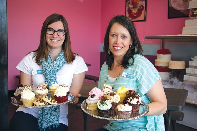 the-call-county-coordinator-julia-descarpentrie-right-and-taylor-brown-display-some-cupcakes-from-sugardumplin-cupcakes-in-bryant-sugardumplin-cupcakes-will-be-one-of-the-12-vendors-providing-desserts-for-the-annual-fundraiser-changing-lives-with-chocolate-set-for-friday-at-the-benton-event-center-proceeds-from-the-event-will-help-serve-foster-and-adoptive-families-in-saline-and-perry-counties