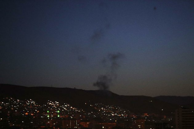 smoke-rises-from-an-area-outside-damascus-early-today-after-airstrikes-targeting-different-sections-of-the-syrian-capital-were-launched-by-the-united-states-and-its-allies-britain-and-france