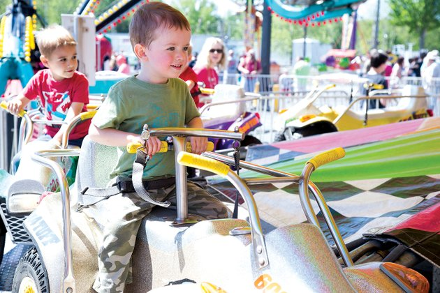 xander-johnson-2-takes-a-ride-at-the-cabot-strawberry-festival-last-year-the-festival-which-will-begin-on-thursday-and-last-till-saturday-is-organized-and-run-by-the-junior-auxiliary-of-cabot