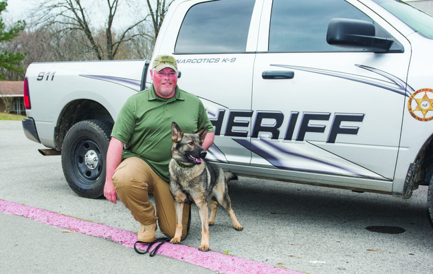 deputy-jeff-mclain-of-the-cleburne-county-sheriffs-office-poses-with-new-k-9-dog-xinie-who-was-put-into-service-in-december-xinie-is-a-german-shepherd-who-came-to-arkansas-from-the-czech-republic