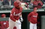 Arkansas second baseman Carson Shaddy follows through with a solo home run Saturday, April 14, 2018, during the second inning against South Carolina at Baum Stadium.