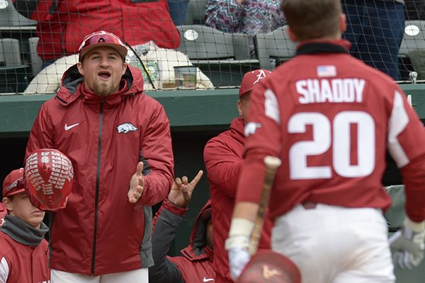 Arkansas infielder Hunter Wilson, facing, waits to greet Carson Shaddy after Shaddy hit a home run during a game against South Carolina on Saturday, April 14, 2018, in Fayetteville.