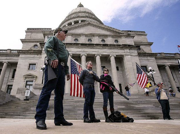 second-amendment-supporters-from-left-ed-matowitz-gary-nicholson-and-jackie-fortin-listen-to-speakers-at-saturdays-rally-outside-the-state-capitol