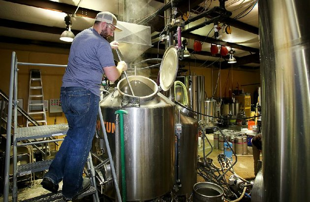 chris-courtney-a-brewer-at-fossil-cove-in-fayetteville-stirs-a-mash-last-week-at-the-companys-birch-avenue-base-the-brewery-is-moving-some-of-its-operation-about-a-half-block-away-to-poplar-street
