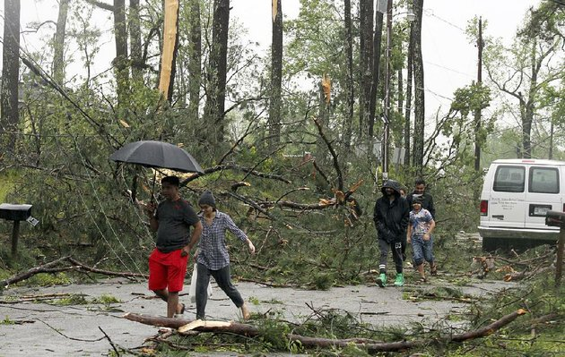 residents-in-meridian-miss-survey-the-damage-saturday-after-a-storm-system-moved-through-downing-power-lines-and-felling-trees