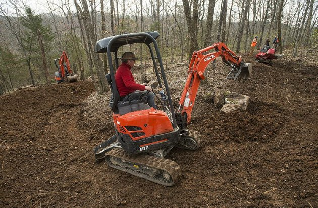 bret-deutscher-with-rock-solid-trail-contracting-works-on-a-section-of-trail-at-lake-leatherwood-park-in-eureka-springs-construction-costs-for-six-new-downhill-trails-is-expected-to-run-almost-1-million