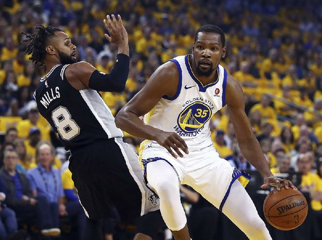 golden-state-forward-kevin-durant-drives-to-the-basket-against-san-antonios-patty-mills-on-saturday-during-the-warriors-113-92-victory-over-the-spurs-in-game-1-of-their-nba-western-conference-playoff-series-durant-led-the-warriors-with-24-points-8-rebounds-and-7-assists