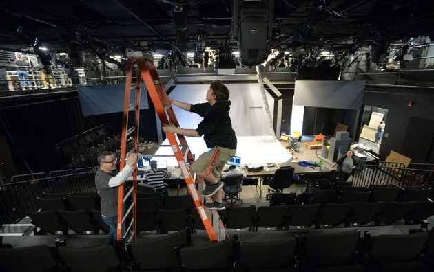 nwa-democrat-gazetteandy-shupe-michael-riha-left-chairman-of-the-university-of-arkansas-theatre-department-steadies-a-ladder-for-austin-aschbrenner-a-first-year-scenic-design-graduate-student-from-beebe-as-they-focus-lights-april-6-inside-the-renovated-global-campus-theatre-on-the-fayetteville-square