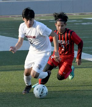 Bud Sullins/Special to Siloam Sunday Siloam Springs freshman Franklin Cortez dribbles ahead of Clarksville's Friday Aye during Tuesday's boys soccer match at Panther Stadium. Siloam Springs defeated Clarksville 4-0.