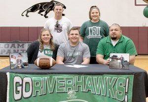 Bud Sullins/Special to Siloam Sunday Siloam Springs senior football player Jackson Knight signed a letter of intent Wednesday to play football as a preferred walk-on at Northeastern State University in Tahlequah, Okla. Pictured are, front from left, mother Beth Knight, Jackson Knight, father Frank Knight; back, former Siloam Springs head football coach Bryan Ross and sister Whitlee Knight.