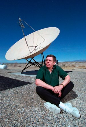 In this March 7, 1997, photo, shows late night talk show host Art Bell near a satellite dish at his Pahrump, Nev., home. Bell, was the original owner of Pahrump based radio station KNYE 95.1 FM. (Aaron Mayes/Las Vegas Sun via AP)