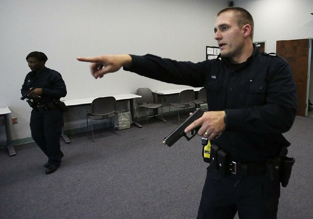 little-rock-police-cadets-cameron-vail-right-and-eboney-warren-run-a-simulation-of-an-investigation-on-friday-at-the-little-rock-police-training-academy-the-department-reported-a-decrease-in-the-number-of-use-of-force-incidents-last-year