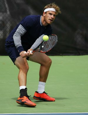 Karue Sell returns a ball during his 7-5, 6-2 victory over Nicolaas Scholtz during the championship match of the USTA Pro Futures Bolo Bash tournament Sunday at Rebsamen Tennis Center in Little Rock.