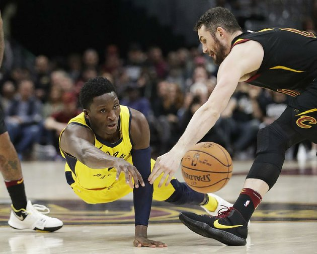 indiana-pacers-guard-victor-oladipo-left-passes-as-cleveland-cavaliers-center-kevin-love-defends-in-the-second-half-of-game-1-of-sundays-nba-eastern-conference-fi-rst-round-series-in-cleveland-oladipo-finished-with-32-points-6-rebounds-4-assists-and-4-steals-to-power-the-pacers-to-a-98-80-victory