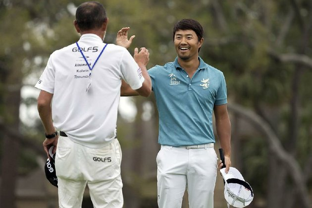 satoshi-kodaira-of-japan-celebrates-a-birdie-putt-on-the-17th-green-with-his-caddie-masanoki-omizo-of-japan-during-a-three-hole-playoff-against-si-woo-kim-of-south-korea-during-the-final-round-of-the-rbc-heritage-golf-tournament-in-hilton-head-island-sc-sunday-april-15-2018
