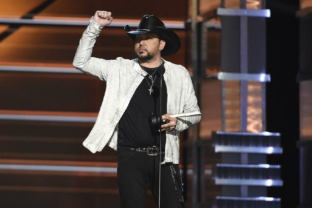 jason-aldean-accepts-the-award-for-entertainer-of-the-year-at-the-53rd-annual-academy-of-country-music-awards-at-the-mgm-grand-garden-arena-on-sunday-in-las-vegas