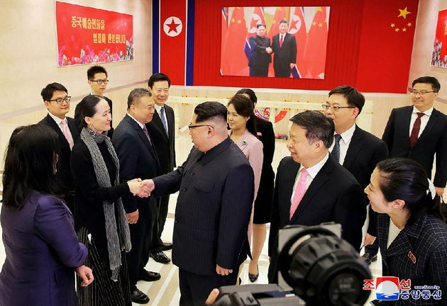 north-korean-leader-kim-jong-un-center-greets-members-of-a-chinese-art-troupe-saturday-in-pyongyang-as-song-tao-center-right-a-chinese-diplomat-looks-on-in-this-photo-provided-sunday-by-the-north-korean-government