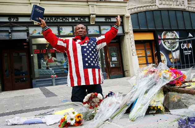 cristopher-nzenwa-of-boston-prays-at-the-site-of-the-first-explosion-during-the-2013-boston-marathon-on-sunday-todays-running-of-the-boston-mara-thon-comes-five-years-after-the-bombing