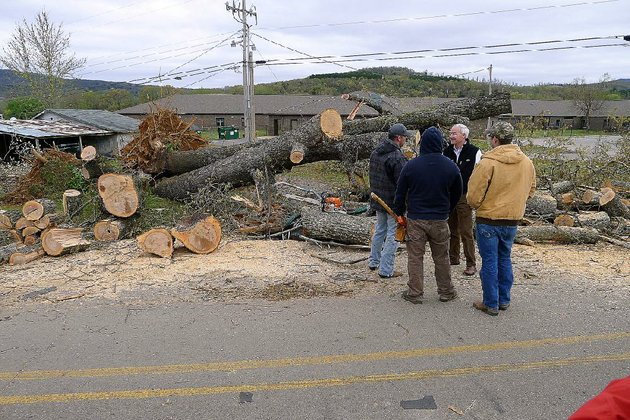 gov-asa-hutchinson-facing-camera-talks-to-volunteers-who-were-helping-clear-trees-sunday-after-a-tornado-hit-mountainburg-on-friday-hutchinson-toured-the-tornado-damage-sunday-morning-and-praised-the-emergency-response