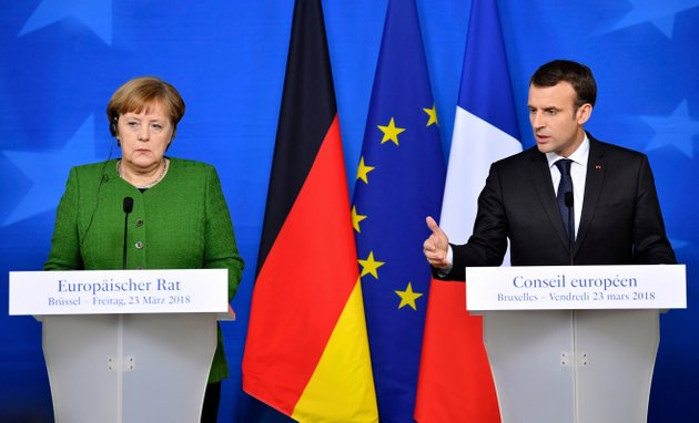 in-this-march-23-2018-file-photo-french-president-emmanuel-macron-right-and-german-chancellor-angela-merkel-speak-at-a-news-conference-in-brussels