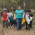 Becky Olthof, Ozark Natural Science Center interim executive director, leads a group of fourth-grade...
