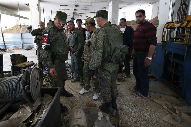 russian-military-police-examine-weapons-monday-left-behind-by-members-of-the-army-of-islam-group-in-a-factory-that-produced-weapons-in-douma-the-site-of-a-suspected-chemical-weapons-attack-near-damascus-syria