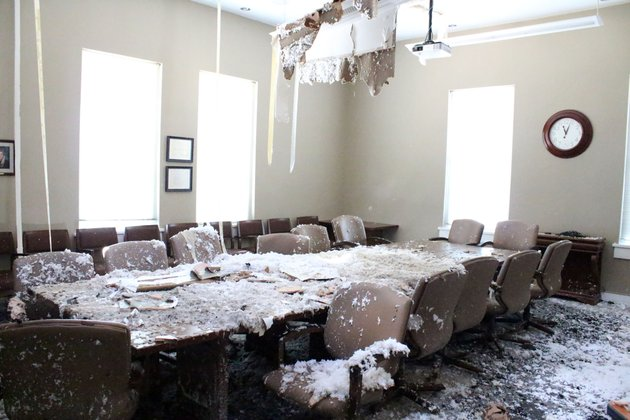the-administration-board-room-at-south-arkansas-community-college-covered-in-wet-insulation-after-the-fire