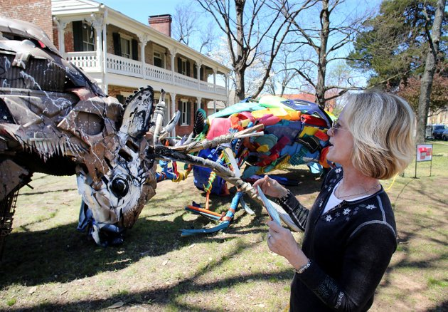 marienne-brown-of-kansas-city-kan-looks-monday-at-the-three-dimensional-piece-by-portuguese-multimedia-artist-bordalo-ii-at-the-walker-stone-house-in-downtown-fayetteville-brown-was-in-fayetteville-visiting-her-daughter-who-attends-the-university-of-arkansas