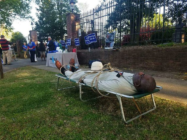 pulaski-county-circuit-judge-wendell-griffen-lies-on-a-cot-tuesday-outside-the-governors-mansion-during-a-vigil-against-capital-punishment-griffen-did-the-same-thing-at-an-anti-capital-punishment-rally-last-year-and-was-subsequently-barred-by-the-state-supreme-court-from-hearing-capital-punishment-cases
