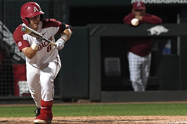 Arkansas outfielder Eric Cole bunts during a game against Missouri State on Tuesday, April 17, 2018, in Fayetteville.