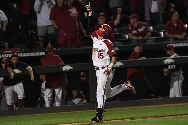 Arkansas third baseman Casey Martin runs to home plate after hitting a home run during a game against Missouri State on Tuesday, April 17, 2018, in Fayetteville.