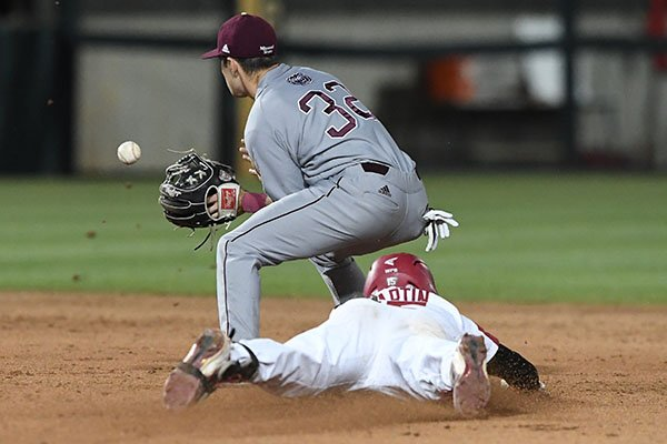 Arkansas' Casey Martin slides into second base while Missouri State second baseman John Privitera awaits a throw during a game Tuesday, April 17, 2018, in Fayetteville.
