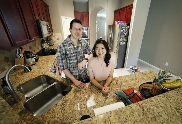 rob-chilton-and-his-wife-saria-stand-in-their-new-house-in-frisco-texas-the-first-time-homebuyers-said-they-paid-more-than-they-could-comfortably-afford-to-get-a-house-near-dallas