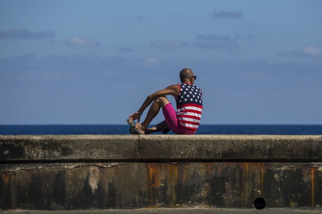 a-man-wearing-a-shirt-with-the-stars-and-stripes-sits-on-the-malecon-in-havana-cuba-wednesday-april-18-2018-cubas-legislature-opened-today-a-two-day-session-that-is-to-elect-a-successor-to-president-castro-ap-photodesmond-boylan