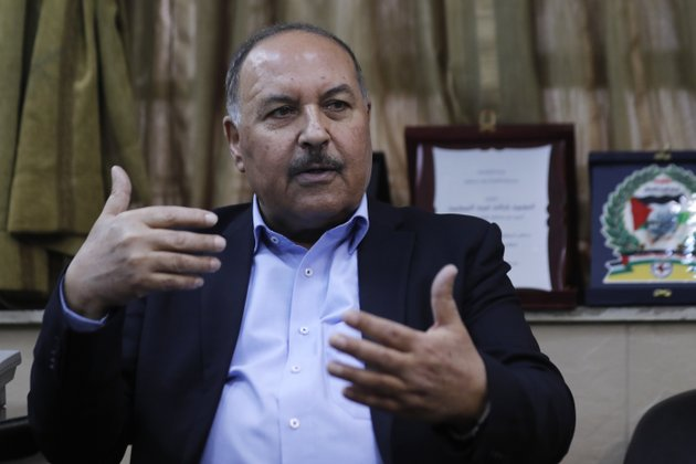 in-this-picture-taken-on-tuesday-april-17-2018-khaled-abdul-majid-a-leader-of-palestinian-resistance-factions-coalition-speaks-during-an-interview-with-the-associated-press-in-damascus-syria-syrian-troops-and-pro-government-palestinian-gunmen-have-been-sending-reinforcements-and-fortifying-their-positions-around-a-refugee-camp-held-by-the-islamic-state-group-south-of-the-capital-damascus-in-preparations-for-an-all-out-offensive-against-the-extremists-if-negotiations-for-their-departure-from-the-area-fails-ap-photohassan-ammar