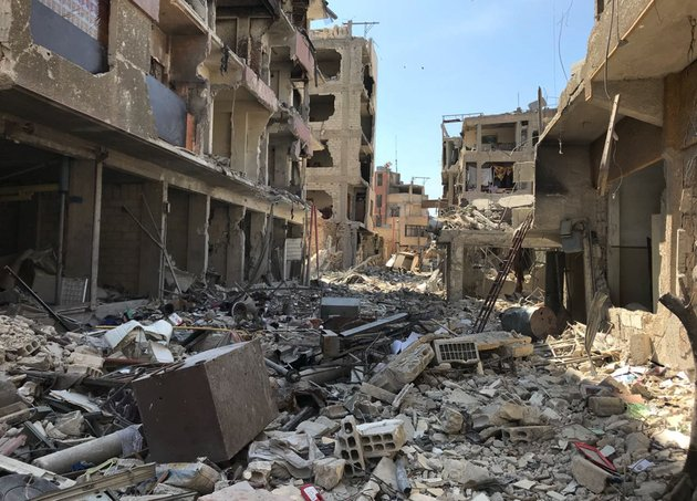 rubble-fills-a-street-in-douma-the-site-of-a-suspected-chemical-weapons-attack-near-damascus-syria-monday-april-16-2018-faisal-mekdad-syrias-deputy-foreign-minister-said-on-monday-that-his-country-is-quotfully-readyquot-to-cooperate-with-the-fact-finding-mission-from-the-organization-for-the-prohibition-of-chemical-weapons-thats-in-syria-to-investigate-the-alleged-chemical-attack-that-triggered-us-led-airstrikes-ap-photohassan-ammar