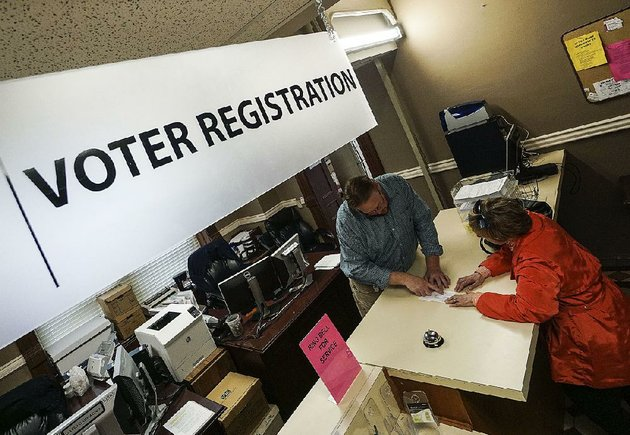 voter-registration-clerk-bart-moreland-left-helps-little-rock-resident-ginny-mcmurry-change-the-address-on-her-voter-registration-thursday-at-the-pulaski-county-county-clerks-office-in-little-rock-monday-is-the-deadline-to-register-to-vote-in-the-may-22-primary-and-nonpartisan-judicial-elections