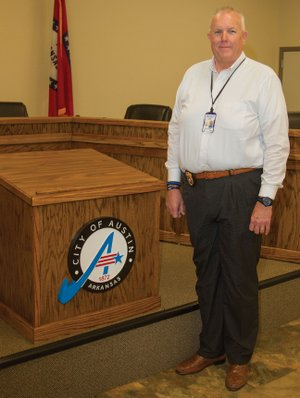 New Austin Police Chief Rick Anderson stands in the municipal courtroom at Austin City Hall. Anderson started the job March 29. He has 30 years of law enforcement experience, working 25 years for the Pulaski County Sheriff's Office and five years with the Little Rock Police Department.