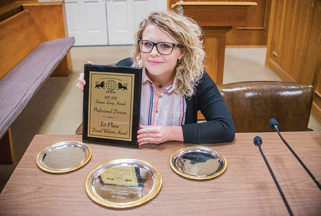 leia-smith-a-cabot-high-school-graduate-and-a-senior-at-the-university-of-central-arkansas-in-conway-displays-the-plaque-and-silver-trays-she-received-from-the-international-public-debate-association-at-a-tournament-in-spokane-wash-she-won-two-national-honors-as-season-long-professional-division-debate-and-speaking-champion-for-2017-2018