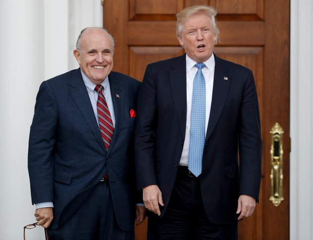 in-this-nov-20-2016-file-photo-then-president-elect-donald-trump-right-and-former-new-york-mayor-rudy-giuliani-pose-for-photographs-as-giuliani-arrives-at-the-trump-national-golf-club-bedminster-clubhouse-in-bedminster-nj