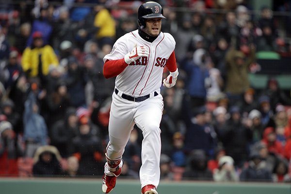 Boston Red Sox's Andrew Benintendi runs after hitting an RBI-triple, allowing Jackie Bradley Jr. to score, in the fifth inning of a baseball game against the Baltimore Orioles, Sunday, April 15, 2018, in Boston. (AP Photo/Steven Senne)