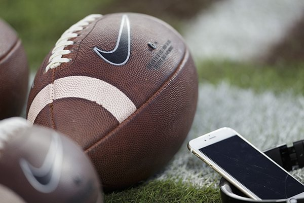 Footballs sit along the sideline of Kyle Field before the start of an NCAA college football game between Ole Miss and Texas A&M Saturday, Nov. 12, 2016, in College Station, Texas. (AP Photo/Sam Craft)